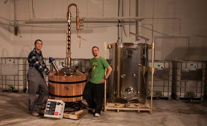 Simeon and Mark welcome their new copper still from Hillbilly Stills