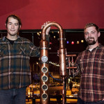 Simeon and Mark showing off their copper still at a Minnesota Distillers Guild meeting