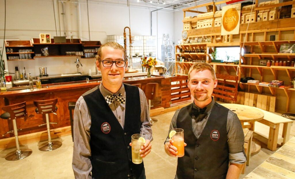 Simeon Rossi and Mark Schiller show off their new cocktail tasting room and distillery production area in Northfield Minnesota.